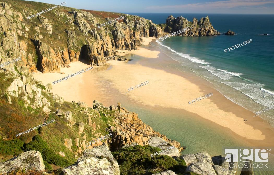 Stock Photo: Pendnvounder Beach and Treen Cliffs with Logans Rock in the background, Cornwall.