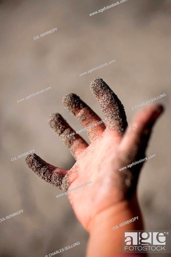 Stock Photo: Sand on child's hand.