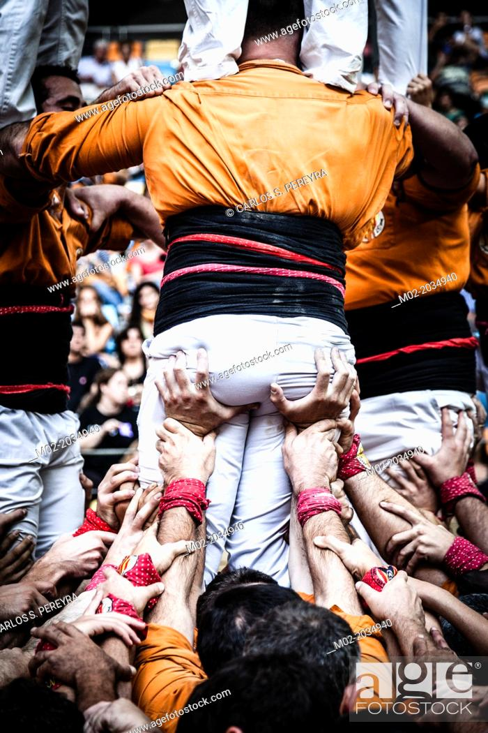 Stock Photo: Tarragona, Spain, Contest Castellers (human towers). The castellers are UNESCO World Heritage.