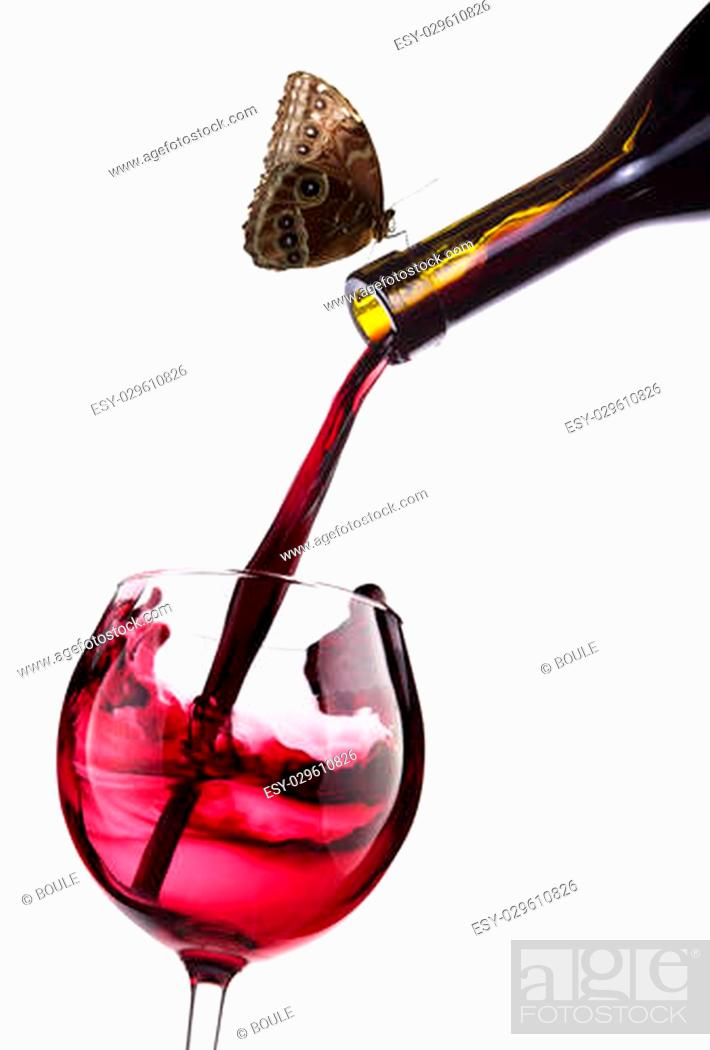 Stock Photo: Splash red wine against a white and butterfly background.