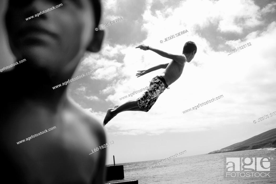 Stock Photo: Boys in the Güimar harbour, Tenerife, Canary Islands, Spain.