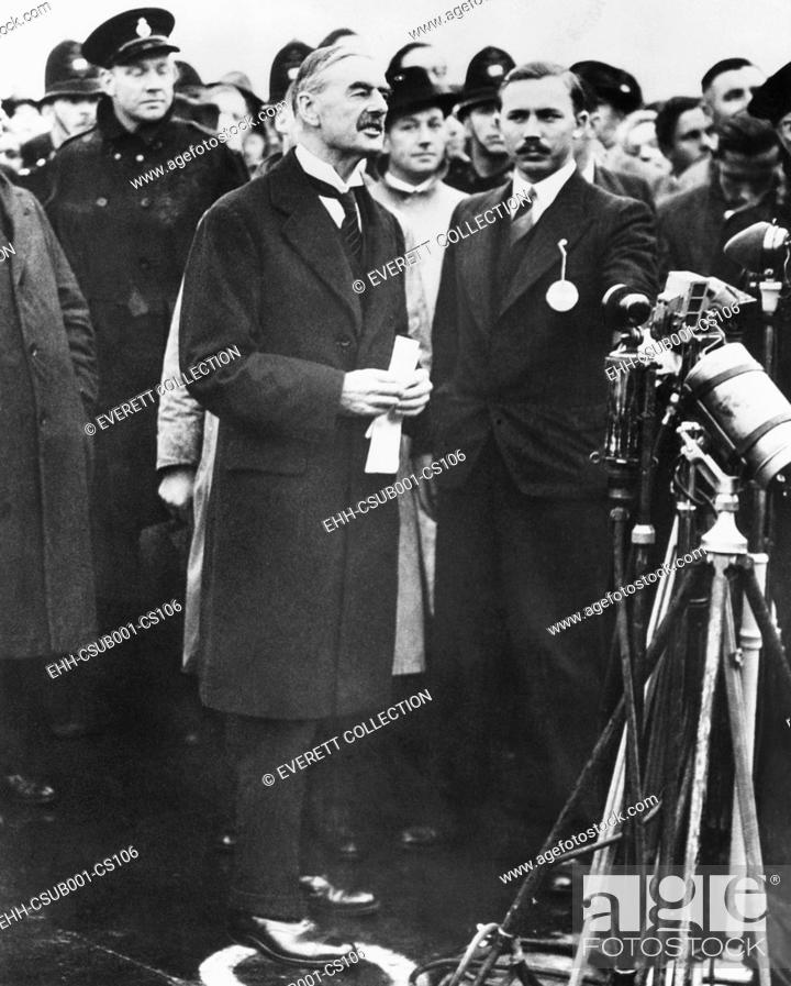 Stock Photo: Neville Chamberlain, Prime Minister of Great Britain reporting there will be 'Peace in our time'. Returning from the Munich Conference, he holds the document.