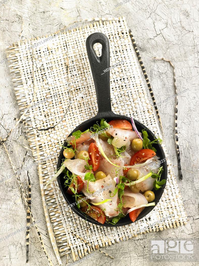 Stock Photo: merluza salteada con verduras y olivas / Hake sautéed with vegetables and olives.