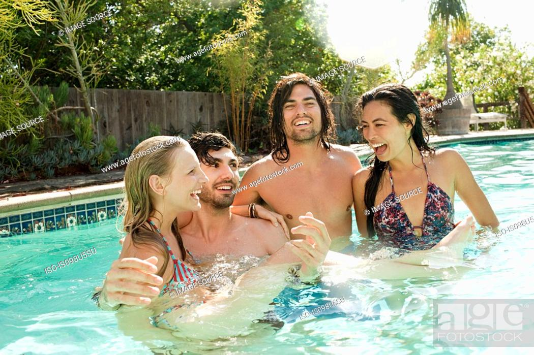 Stock Photo: Young friends in swimming pool on vacation.