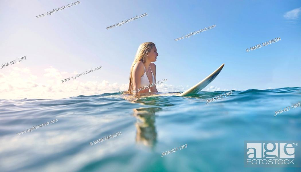 Stock Photo: Girl on surfboard, New South Wales, Australia, Pacific.