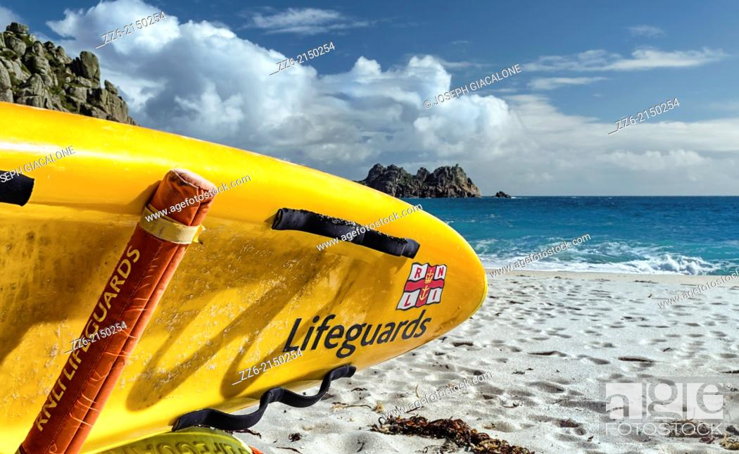 Stock Photo: Lifeguard surfboard at Porthcurno Beach. Cornwall, England.