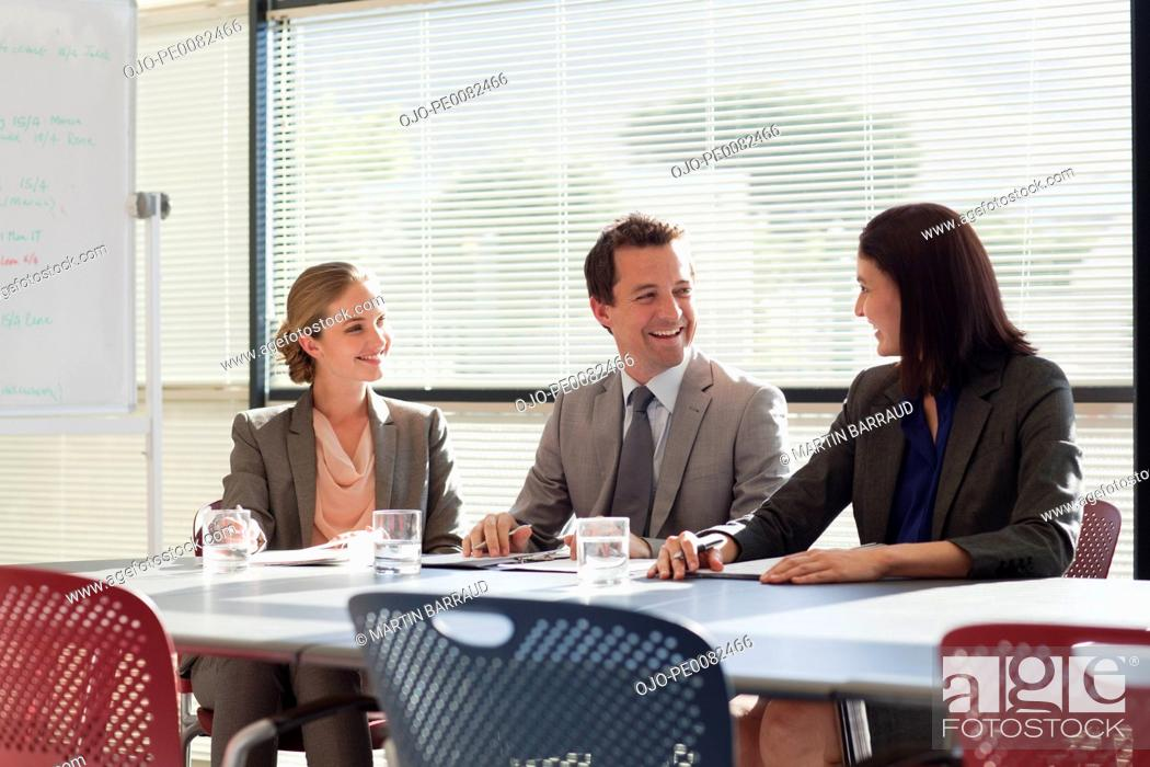 Photo de stock: Business people meeting at table in conference room.