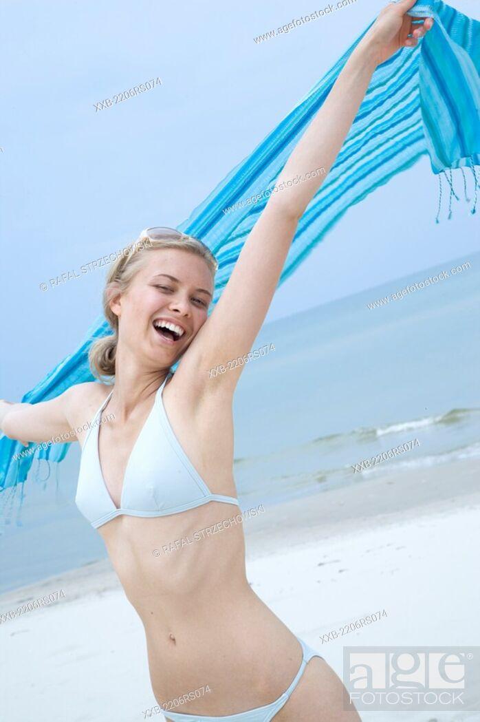 Stock Photo: happy woman on the beach.