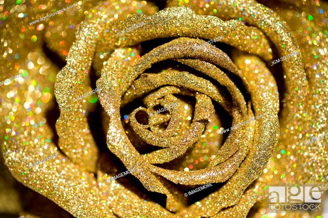 Stock Photo: A golden plastic rose.