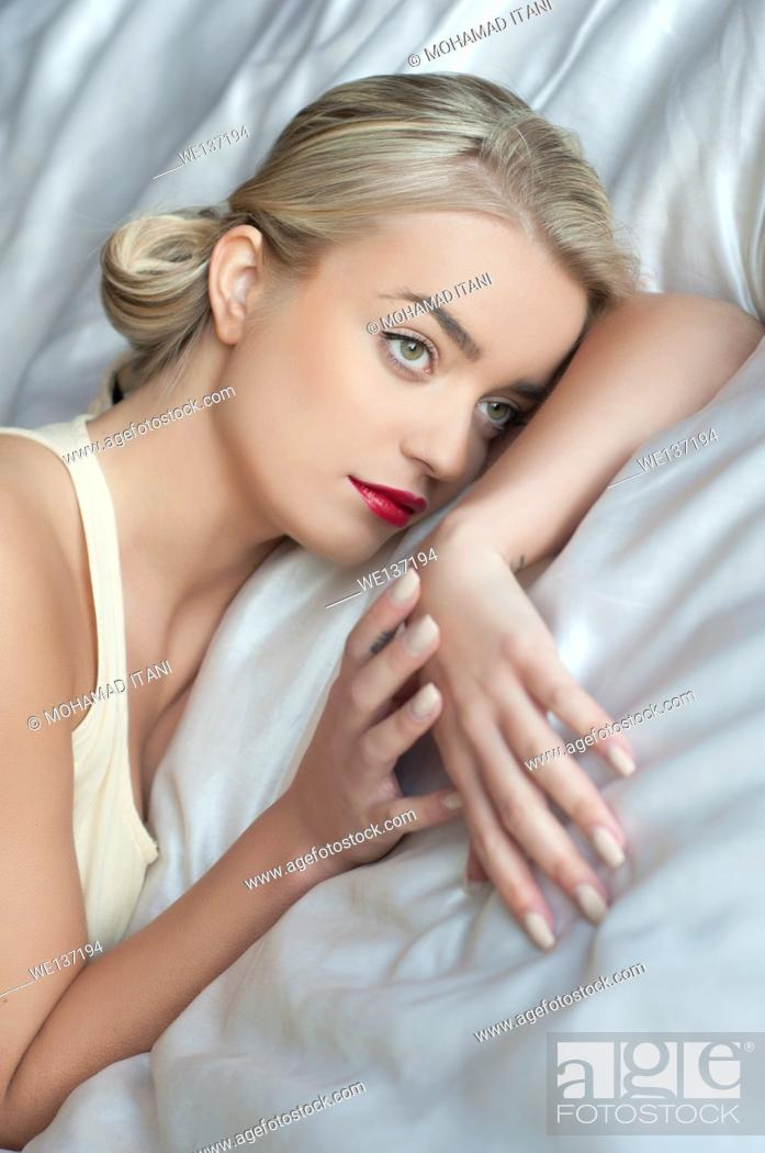 Stock Photo: Beautiful young woman in bed.