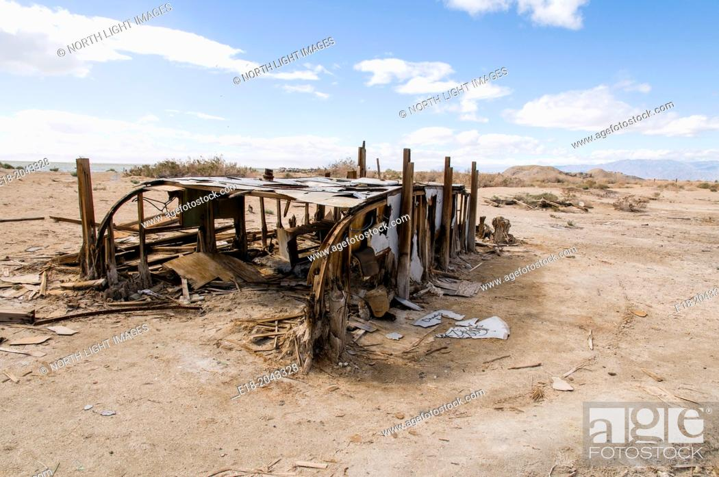 Stock Photo: USA, California, Salton Sea, Bombay Beach. Skeletal remains of long ago abandoned camping trainer on the beach of former seaside resort town.