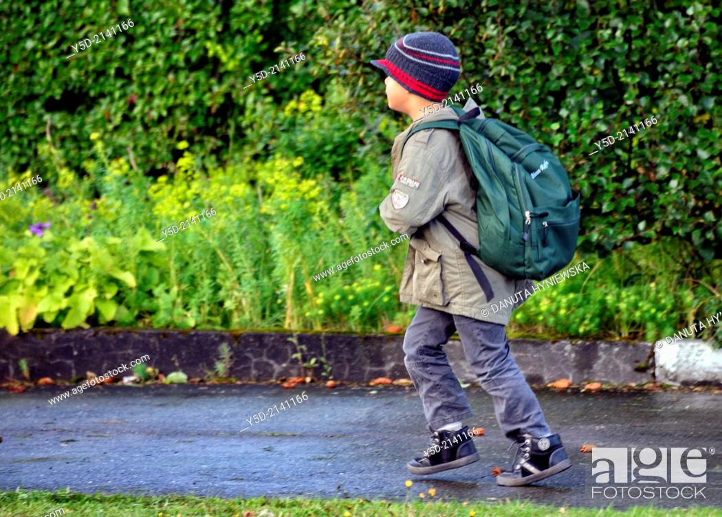 Stock Photo: Little boy running to school in Reykjavik, Icelandic children are quite independent especially comparing to the rest of Europe.