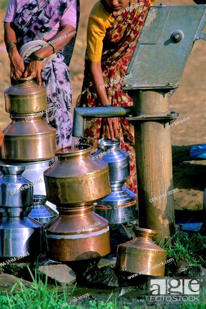 Stock Photo: water hand pump in village ; maharashtra ; india.
