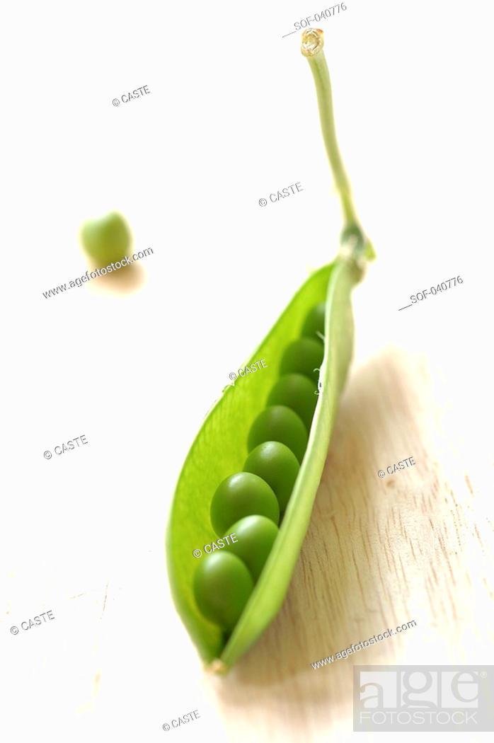 Stock Photo: opened pod of peas.