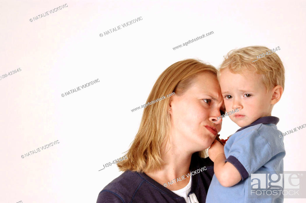 Stock Photo: Mother looking sadly at son.