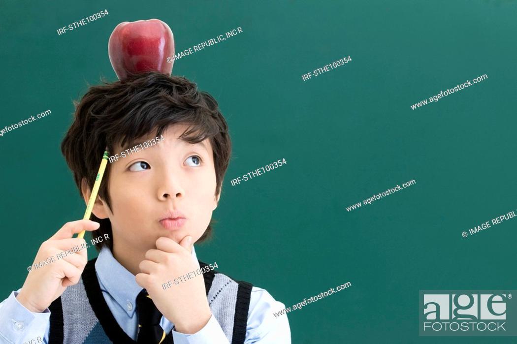 Stock Photo: boy in front of blackboard.