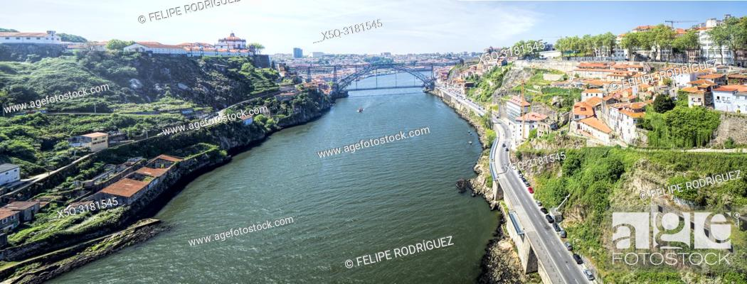 Stock Photo: Panoramic view of the Douro river, the Luis I bridge and the city of Porto from Infante bridge, Portugal.