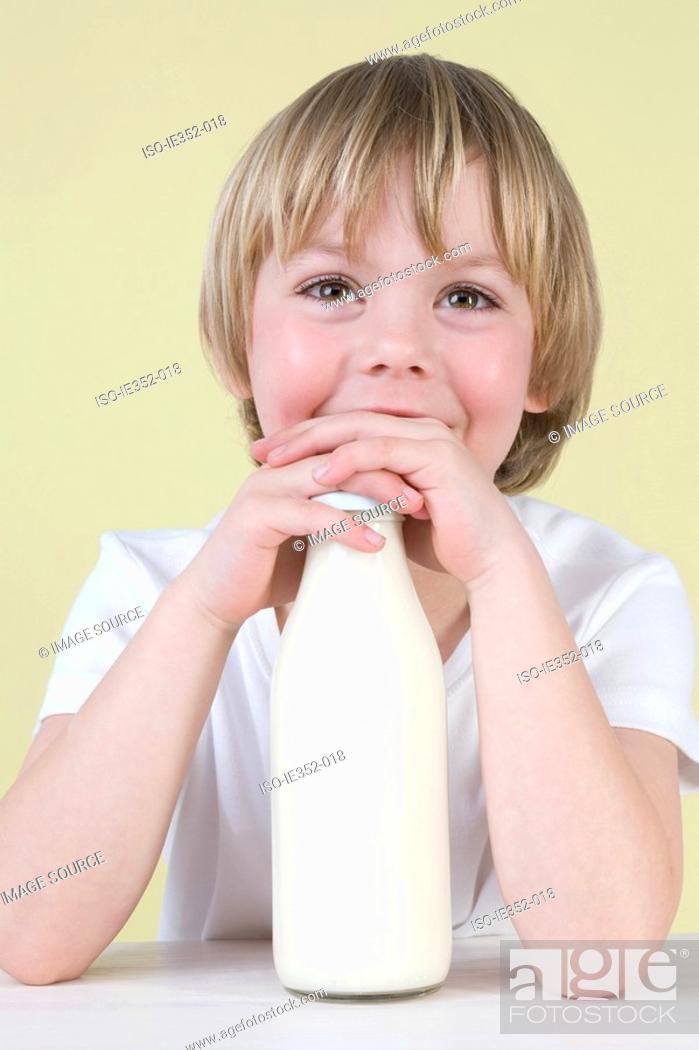 Stock Photo: Boy with milk.