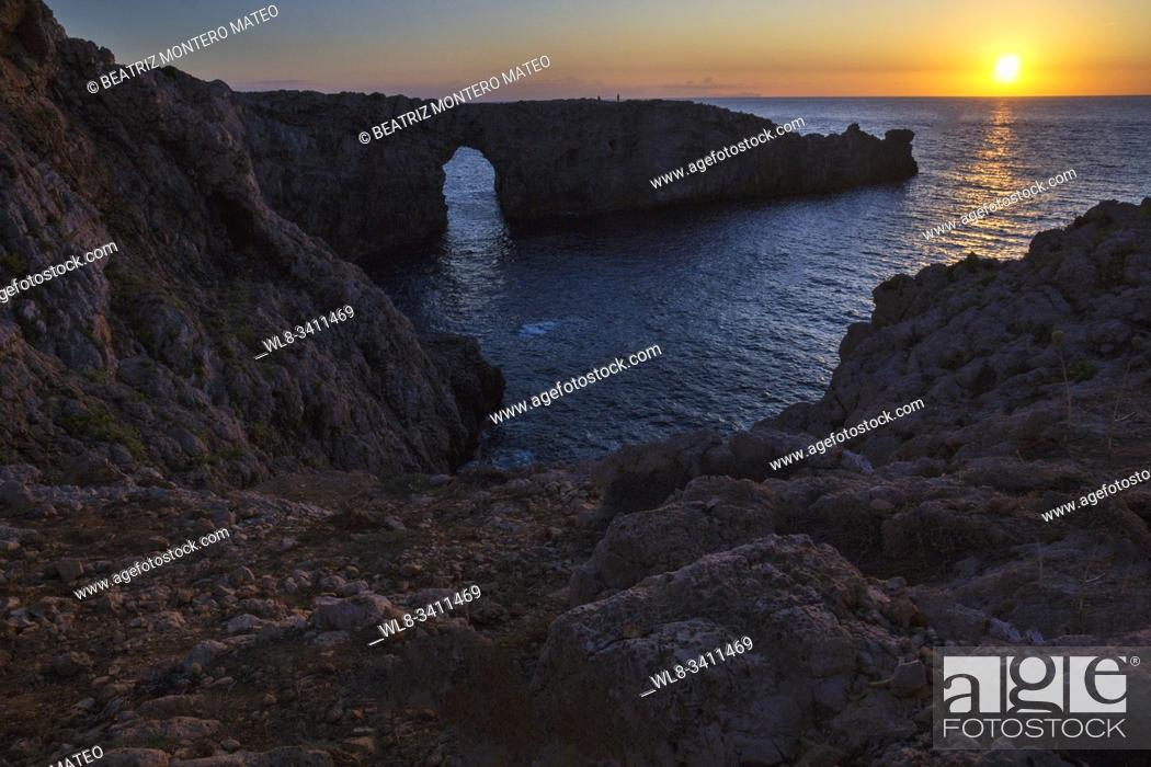 Stock Photo: Sunset on Pont d'en Gil in Menorca (Baleares, Spain). Awesome sunset in the famous place of Menorca.