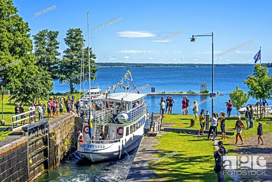 """Stock Photo: The old passenger boat """"""""Kung Sverker"""""""" leave a lock on the Gota Canal at Borenshult, Ostergotland, Sweden, Scandinavia. The Gota Canal was constructed in the."""
