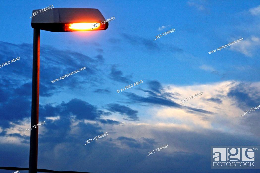 Stock Photo: Lamp lit at dawn.