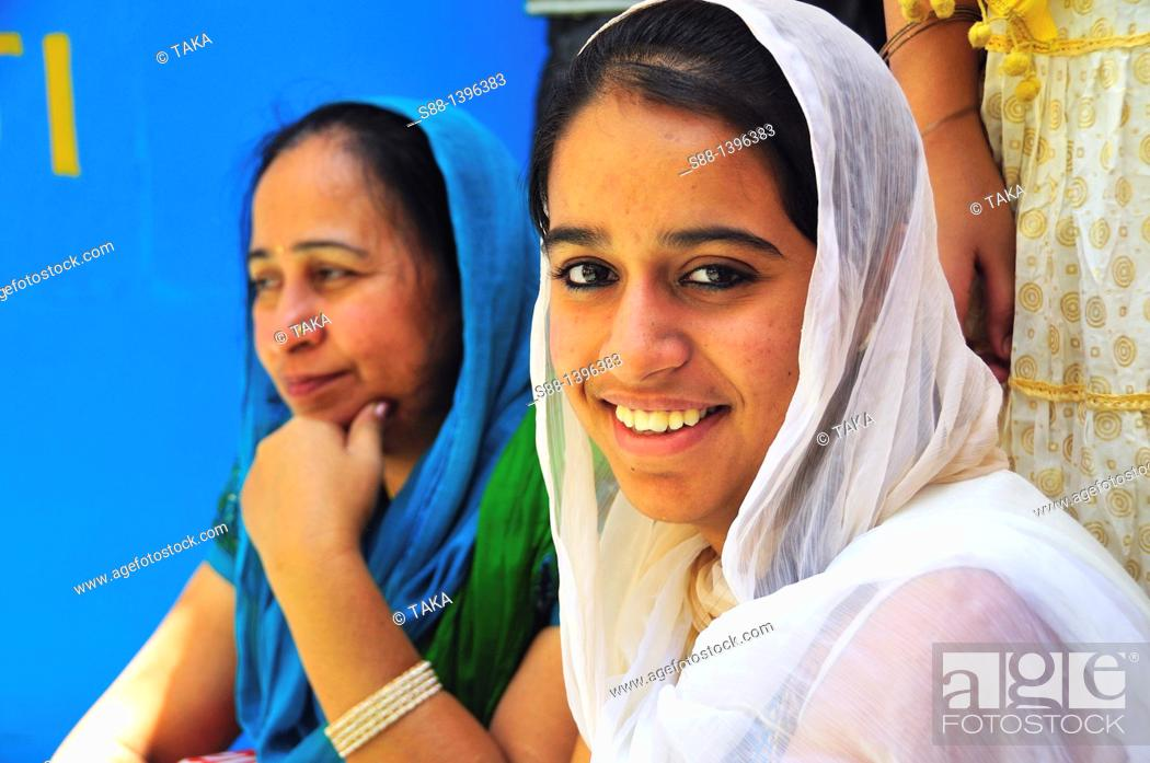 Stock Photo: Sikh pilgrim women at Gurudwara Temple in Manikaran.