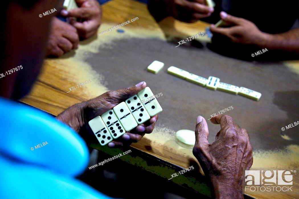 Stock Photo: Men playing dominoes in Antón, Panamá.