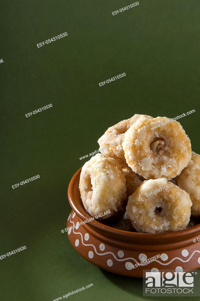 Stock Photo: Indian Traditional Sweet Food Balushahi on a olive green background.