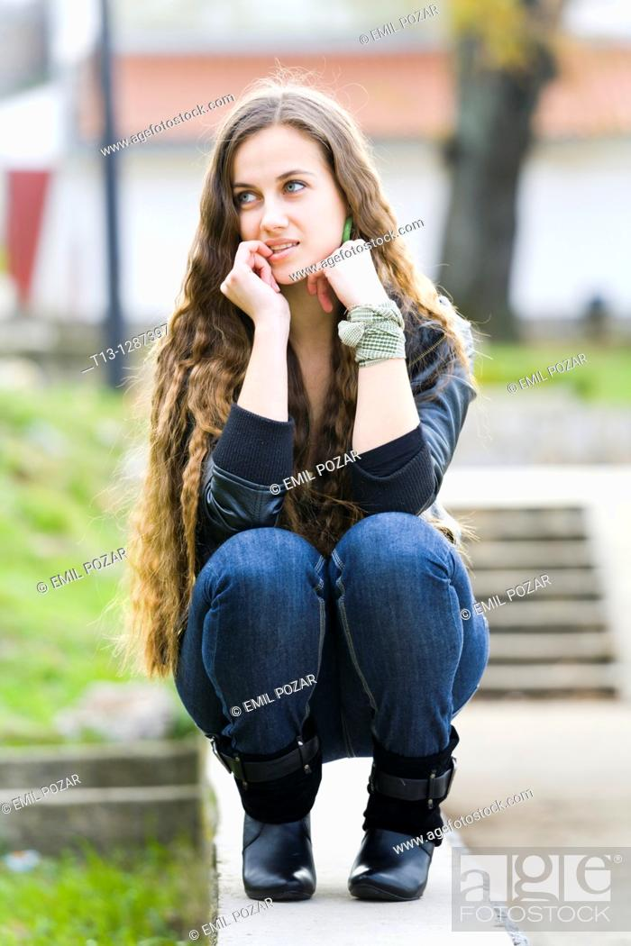 Stock Photo: Young woman is considering.