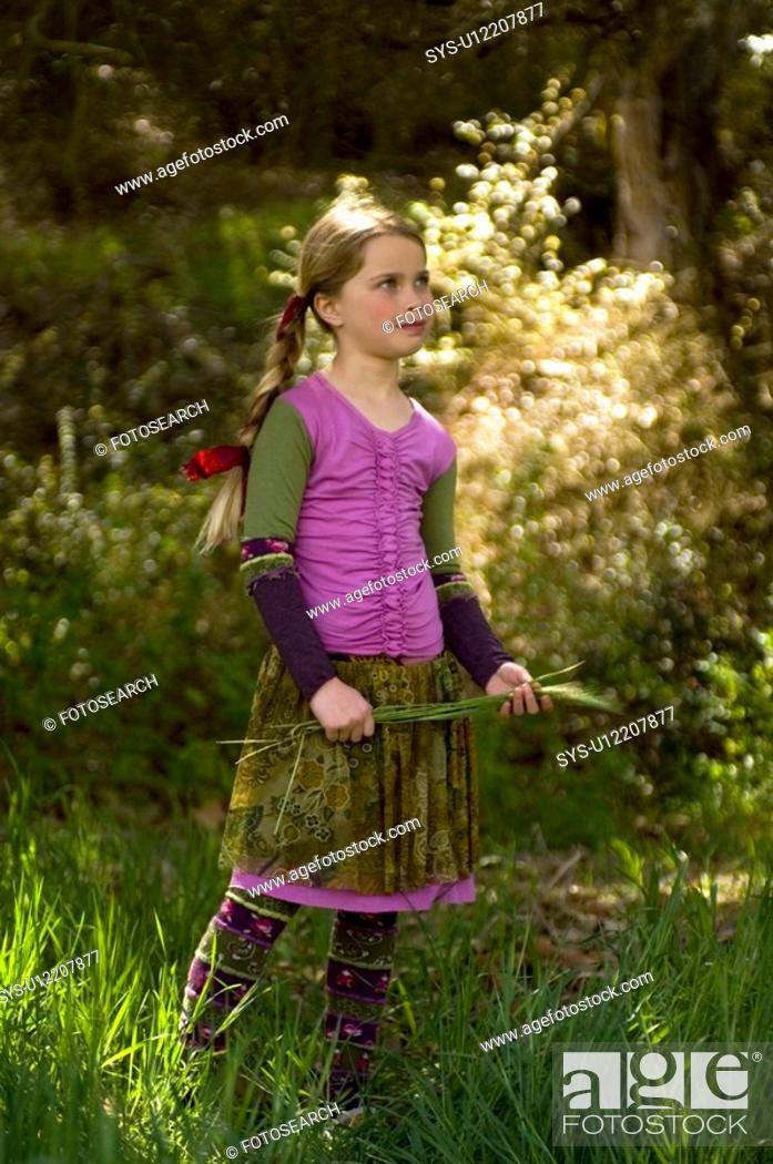 Stock Photo: Portrait of a young girl outside.