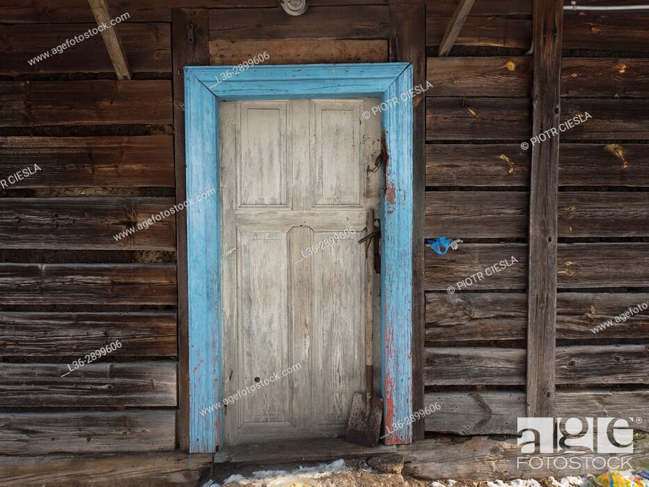 Stock Photo: Poland. Blue door in a wooden house.