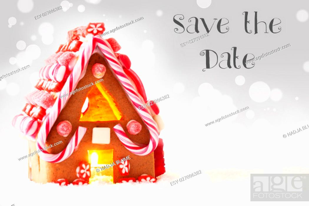 Stock Photo: English Text Save The Date. Gingerbread House In Snowy Scenery As Christmas Decoration. Candlelight For Romantic Atmosphere.