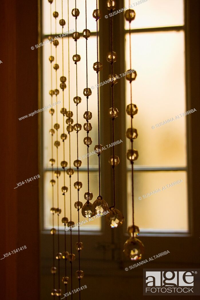 Stock Photo: Crystal beaded curtain in front of a window.