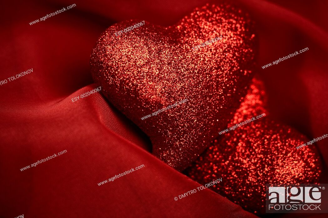 Stock Photo: abstract Valentine's backgrounds over red textile with tho hearts.