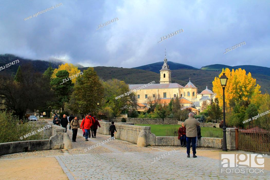 Stock Photo: View over the monastery of El Paular from the Puente del Perdón (Bridge of the Pardon) in a cold and cloudy Autumn morning; this bridge was the last point where.