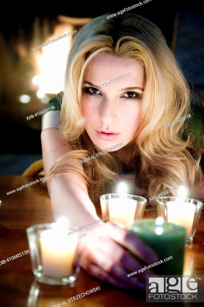 Stock Photo: young woman with candles.