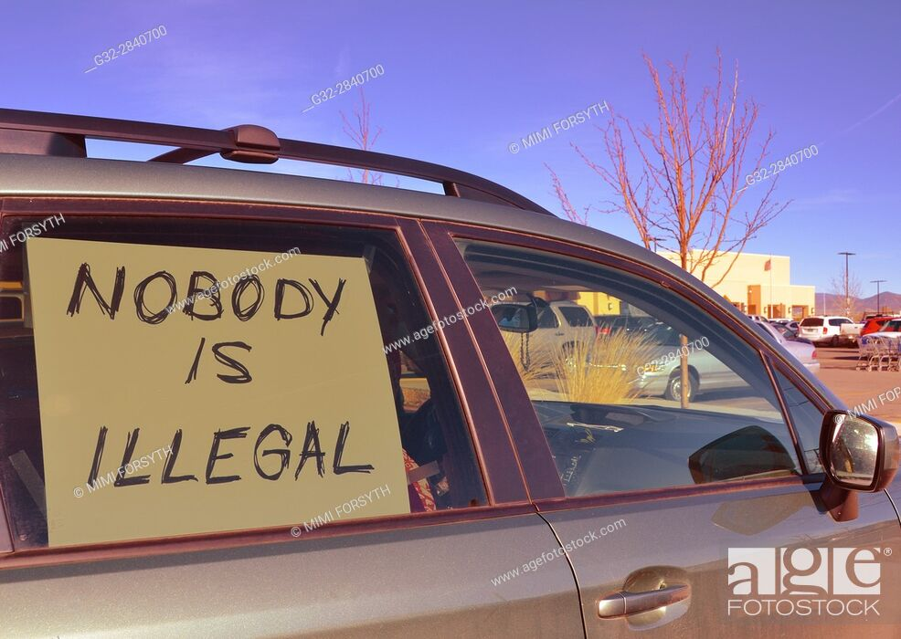 Stock Photo: sign in car window, New Mexico (pertaining to immigration policies). A protest.