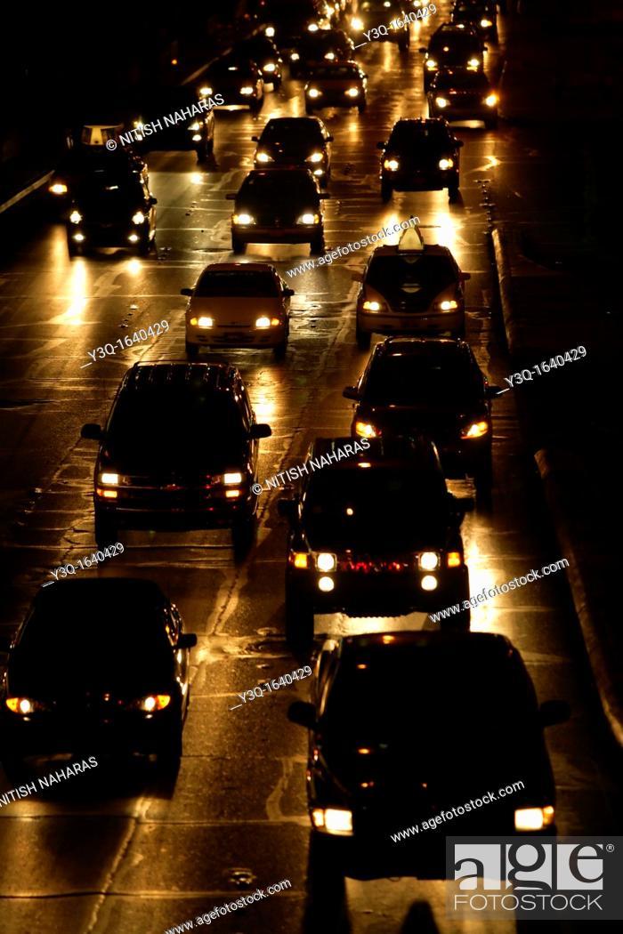Stock Photo: Vehicle traffic on a rainy night.