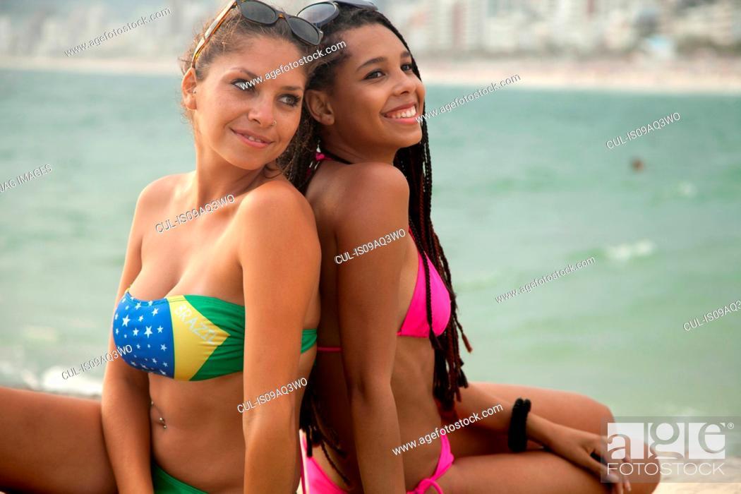 Bikinis Wearing Young Women Ipanema On Sitting Two To Back SGqpzLUVM