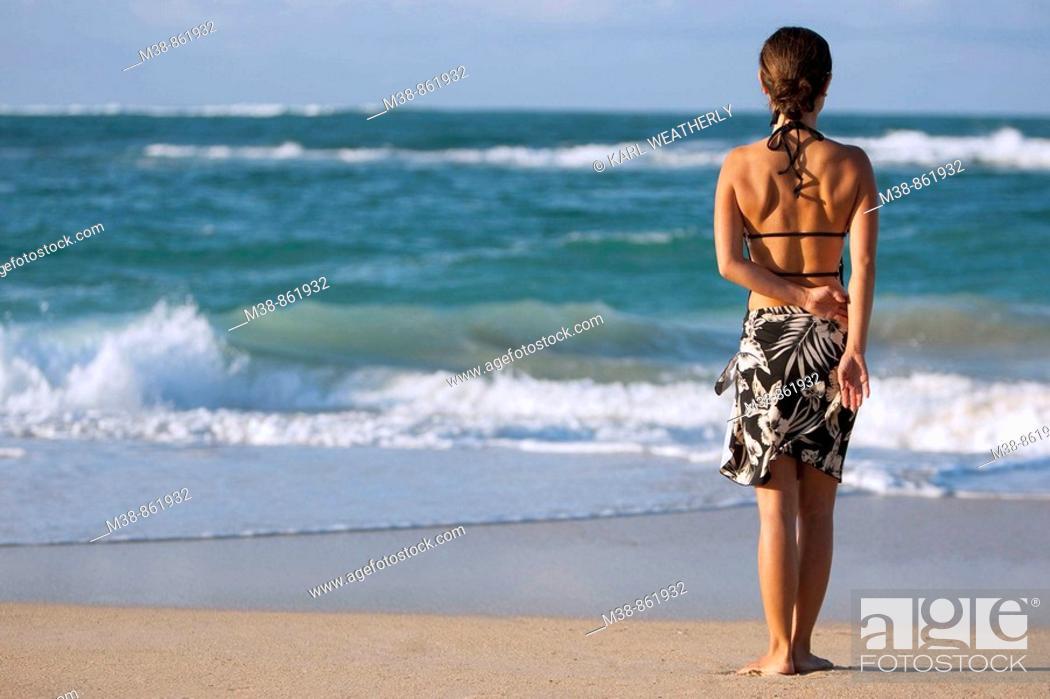 Stock Photo: Woman standing on the beach  Maui, Hawaii.