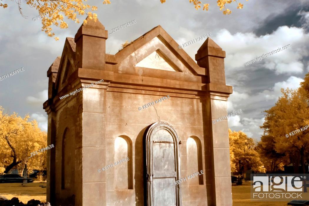 Stock Photo: Infrared photography of a Grave mausoleum in Calvert cemetery, Calvert, Texas.