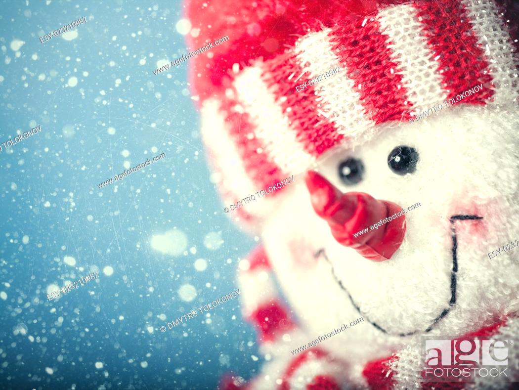Stock Photo: Funny snowman portrait against snowfall, abstract christmas backgrounds.