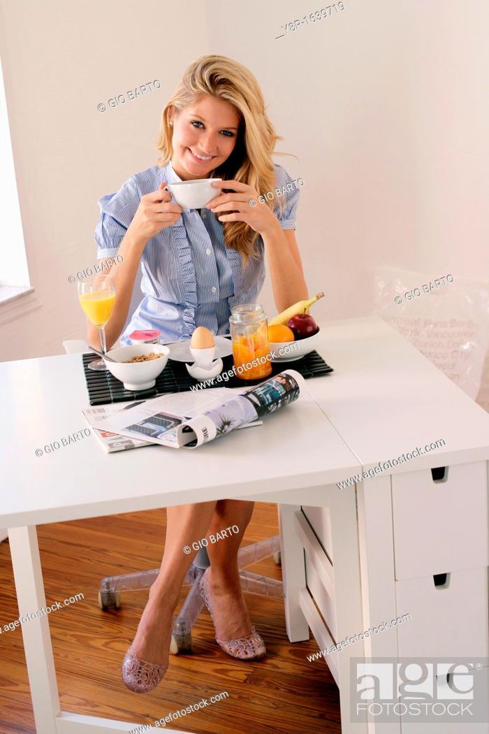 Stock Photo: Woman having breakfast.