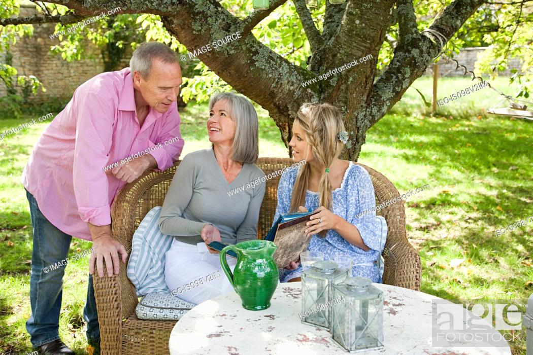 Stock Photo: Family sitting at table.