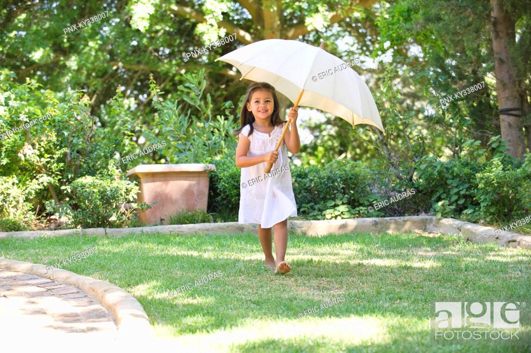 Stock Photo: Cute little girl holding an umbrella.
