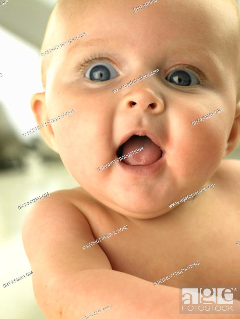 Stock Photo: Baby with wide eyes and mouth open.