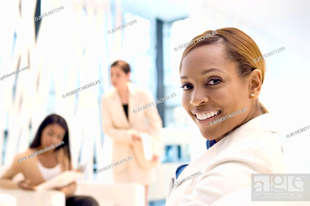 Stock Photo: Businesswomen working in conference room.