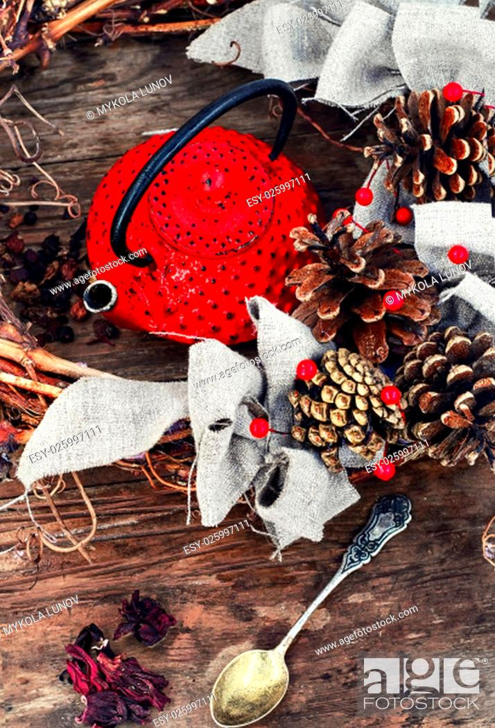 Stock Photo: Retro red cast iron kettle and cane wreath with cones.