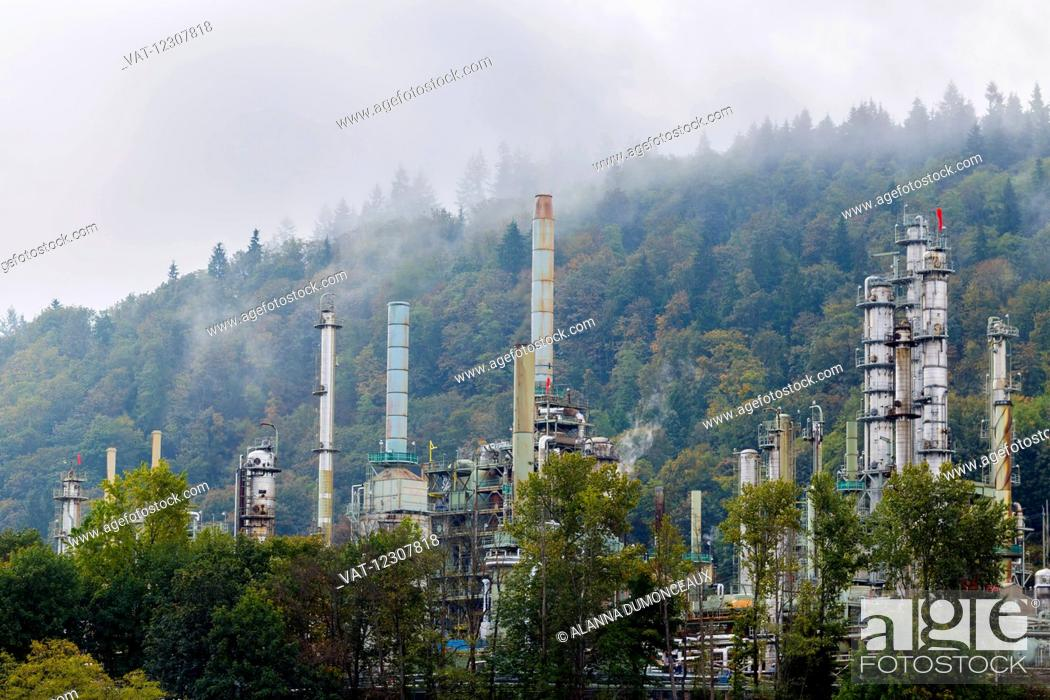 Stock Photo: A Vancouver petroleum oil refinery in the Burrard Inlet at the base of Burnaby Mountain recieves raw oil and gas from pipelines and processes the raw product.