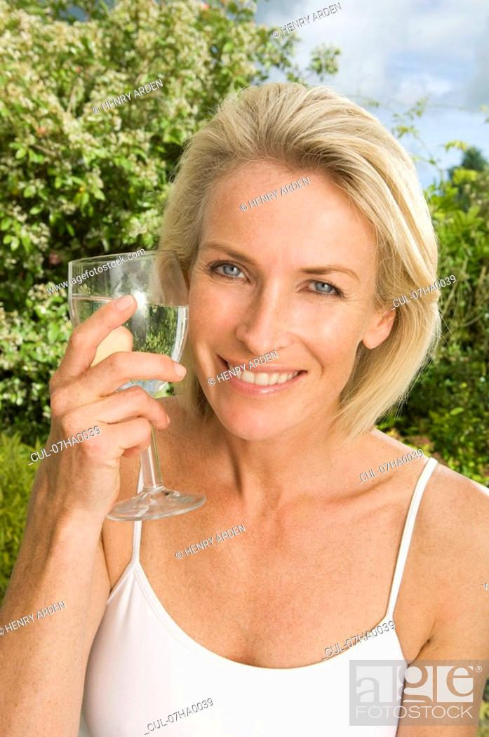 Stock Photo: Portrait of woman with glass of water.